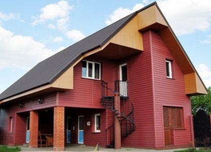 Дом облицованный акриловым сайдингом