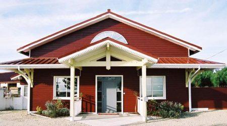 Дом облицованный деревянным сайдингом